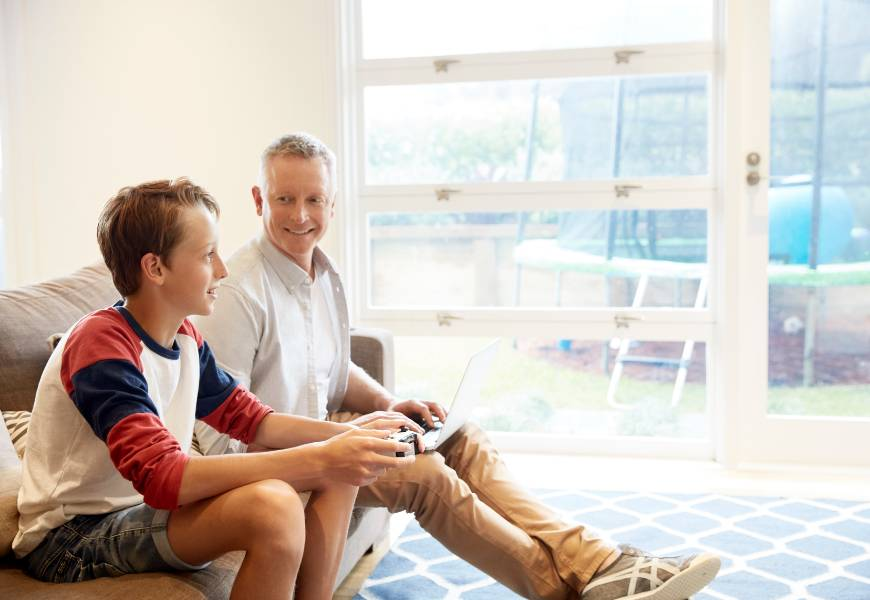father-laptop-son-gaming