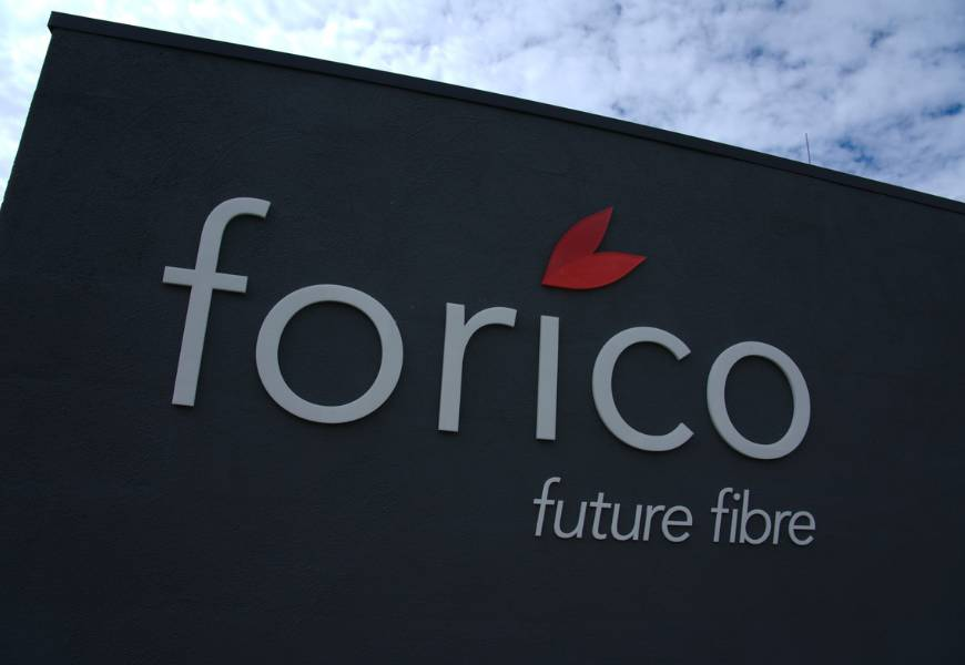 Dark grey coloured sign outside building that reads 'Forico future fibre'