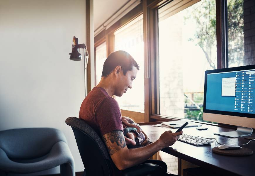 male-working-from-home-computer-baby